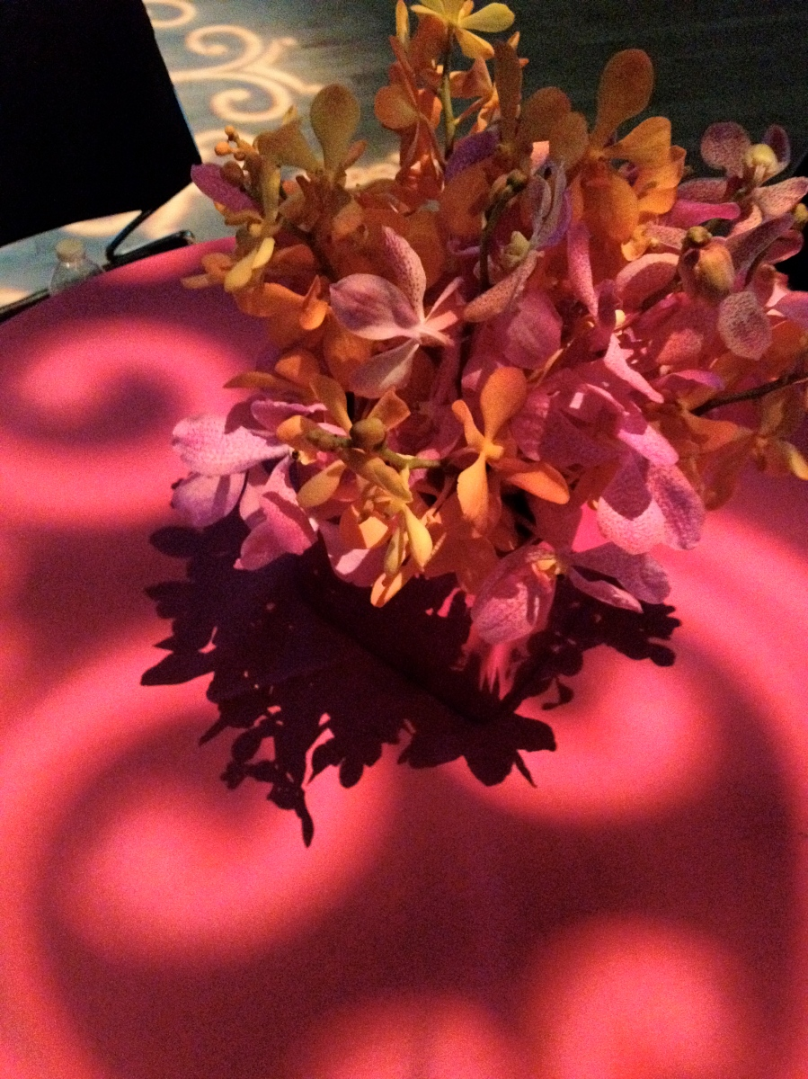 Love the lights on the tables with the flowers!